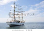 stock-photo-big-sailing-ship-is-at-anchor-in-port-at-the-stern-of-the-vessel-flag-of-russia-63755092