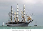 stock-photo-classic-pirate-ship-sailboat-on-the-sea-with-cloudy-background-4945345