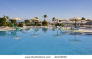 stock-photo-swimming-pool-on-a-sunny-day-hurghada-city-in-egypt-44078599