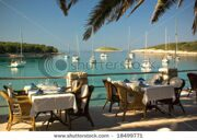 stock-photo-served-tables-at-yachting-club-beach-restaurant-18499771