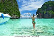 stock-photo-woman-in-beautiful-lagoon-at-phi-phi-ley-island-the-exact-place-where-the-beach-movie-was-filmed-41545936