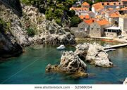 stock-photo-a-boat-in-rocky-bay-of-dubrovnik-52588054