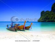stock-photo-long-tailboats-by-the-shore-at-hong-island-krabi-thailand-against-beautiful-clear-blue-sky-17191687