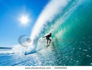 stock-photo-surfer-on-amazing-blue-wave-in-the-barrel-epic-tube-54425062