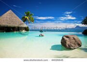 stock-photo-infinity-pool-with-artificial-beach-and-tropical-ocean-44026645