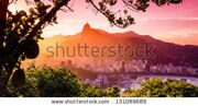stock-photo-buildings-at-the-waterfront-with-christ-the-redeemer-statue-in-the-background-corcovado-rio-de-151089689