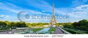 stock-photo-eiffel-tower-panorama-with-cloudy-blue-sky-and-surrounding-park-22775017