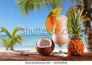 stock-photo-summer-drink-on-wooden-table-cocktails-with-blue-sky-tropical-becha-and-fresh-fruits-195529946