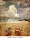 stock-photo-two-sun-beach-chairs-on-shore-near-sea-in-grunge-and-retro-style-58823959