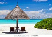 stock-photo-canvas-chairs-with-parasol-on-a-beautiful-beach-13062079